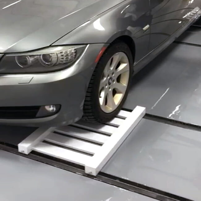 Car Dolly and track system. Sturdy lightweight design. Easy handling of cars.